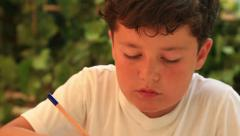 Cute kid doing homework 3 Stock Footage