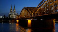 Gothic Cathedral and iron bridge across Rhine river after sunset. Cologne Stock Footage