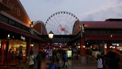 Dusk passage at Asiatique, walk backwards on modern shopping alley, glide shot Stock Footage