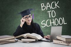 Clever learner with mortarboard back to school Stock Photos