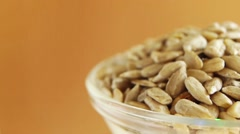 Sunflower seeds in plate Stock Footage