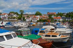 Stock Photo of Boats tied at the harbor in Frogn, Norway.