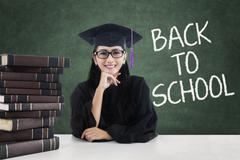 Lovely student with mortarboard back to school Stock Photos