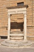 Old stone water well in Italy - stock photo