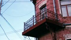 Fancy old-fashioned balcony, red antique building - stock footage