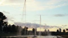 Long shot of the fountains at the city pond - stock footage