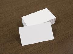 Blank business cards on a wooden background - stock photo