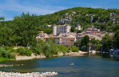 The medieval town of Vogue over the River Ardeche - stock photo
