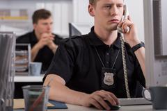 Policeman during his work - stock photo