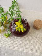 St. John's wort oil in bottle - stock photo