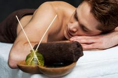 Young man relaxing on massage table - stock photo