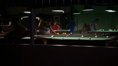 Men playing pool in the bar the night Stock Footage