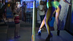 Girls ass naked go-go dancers PJ in a disco near the nightclub Stock Footage