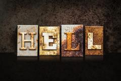 Hell Letterpress Concept on Dark Background Stock Photos