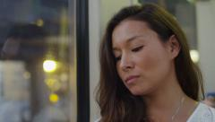 4K Attractive woman on a train on her phone in slow motion, shot on RED EPIC Stock Footage