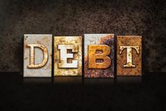 Debt Letterpress Concept on Dark Background Stock Photos