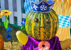 Large pumpkin originally executed as an amusing figurine. Stock Photos