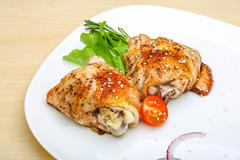 Roasted chicken thighs - stock photo