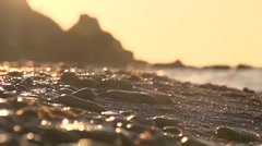 Morning embankment . The sea washes sea stones close-up. Slow motion. - stock footage