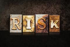 Risk Letterpress Concept on Dark Background Stock Photos
