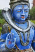 Shiva statue at Ganga Talao Hindu temple, Mauritius. Stock Photos