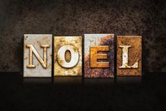 Noel Letterpress Concept on Dark Background - stock photo