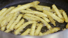 French fries in hot oil - stock footage