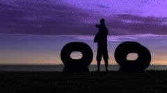 Man  with daughter Sunset landscape space Sea Stock Footage