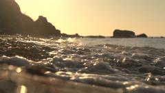 Morning sea. The flow of the waves to the shore. - stock footage