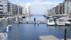 Mol port yachts ,sweden flag 2 Stock Footage