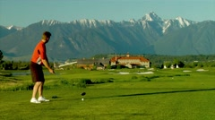 Golfing in the Rocky Mountains. - stock footage