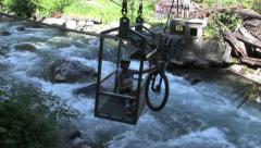 Mountain Bikers Crossing River with Cable Car in Rocky Mountains Stock Footage