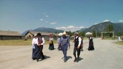Pioneers on a Sunday Stroll in Costume in Pioneer Village Stock Footage