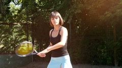 View from behind the grid, beautiful sportswoman playing tennis, slow motion 3 Stock Footage