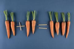 Carrots and children mathematics Stock Photos
