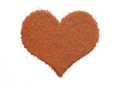 Instant coffee granules in a heart shape Stock Photos