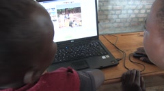 Two African Students Using Computer In A Class In Rwanda - stock footage