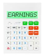 Calculator with EARNINGS - stock photo