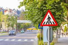 Warning sign for pedestrian crossing Stock Photos