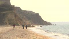 People walk along the seaside promenade. Stock Footage