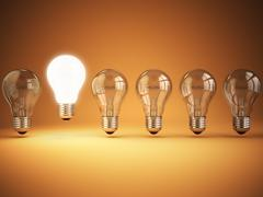 Stock Illustration of Idea or uniqueness, originality concept. Row of light bulbs with glowing one