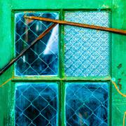 Isolated old neglected green window Stock Photos