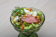 Salmon and avocado salad - stock photo