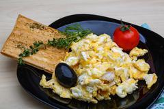 Scrambled eggs with tomato Stock Photos