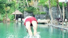 Man jump and swim in swimming pool, slow motion shot at 120fps Stock Footage
