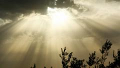 Glorious sky with rays of light through clouds time lapse - stock footage