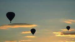 Flying hot air Balloons 33 - Three balloons flying in sunset - backlight Stock Footage