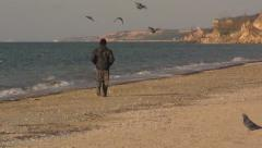 Man alone is on the beach, flying doves. Slow motion. Stock Footage
