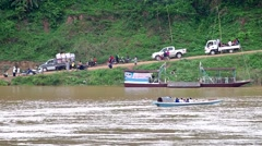 Small motor boat and people activity at the Mekong bank Stock Footage
