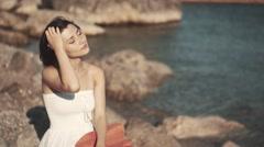 Beautiful girl in a long white wedding dress in Greek style Stock Footage